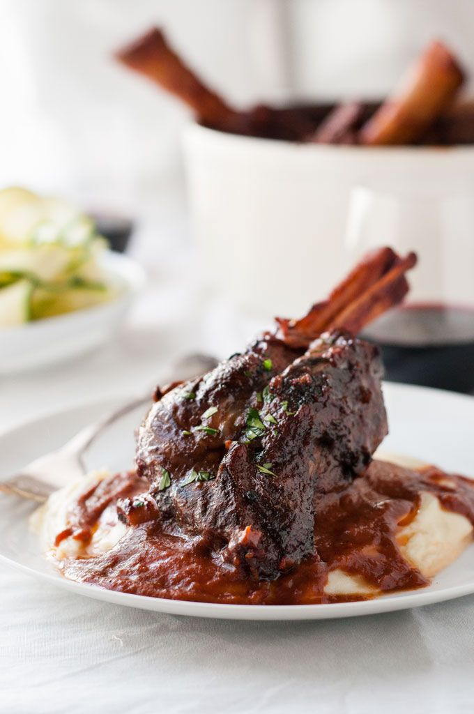 Slow Cooked Lamb Shanks in Red Wine Sauce - a classic recipe, meltingly tender meat and a rich red wine based gravy. Easy to make!
