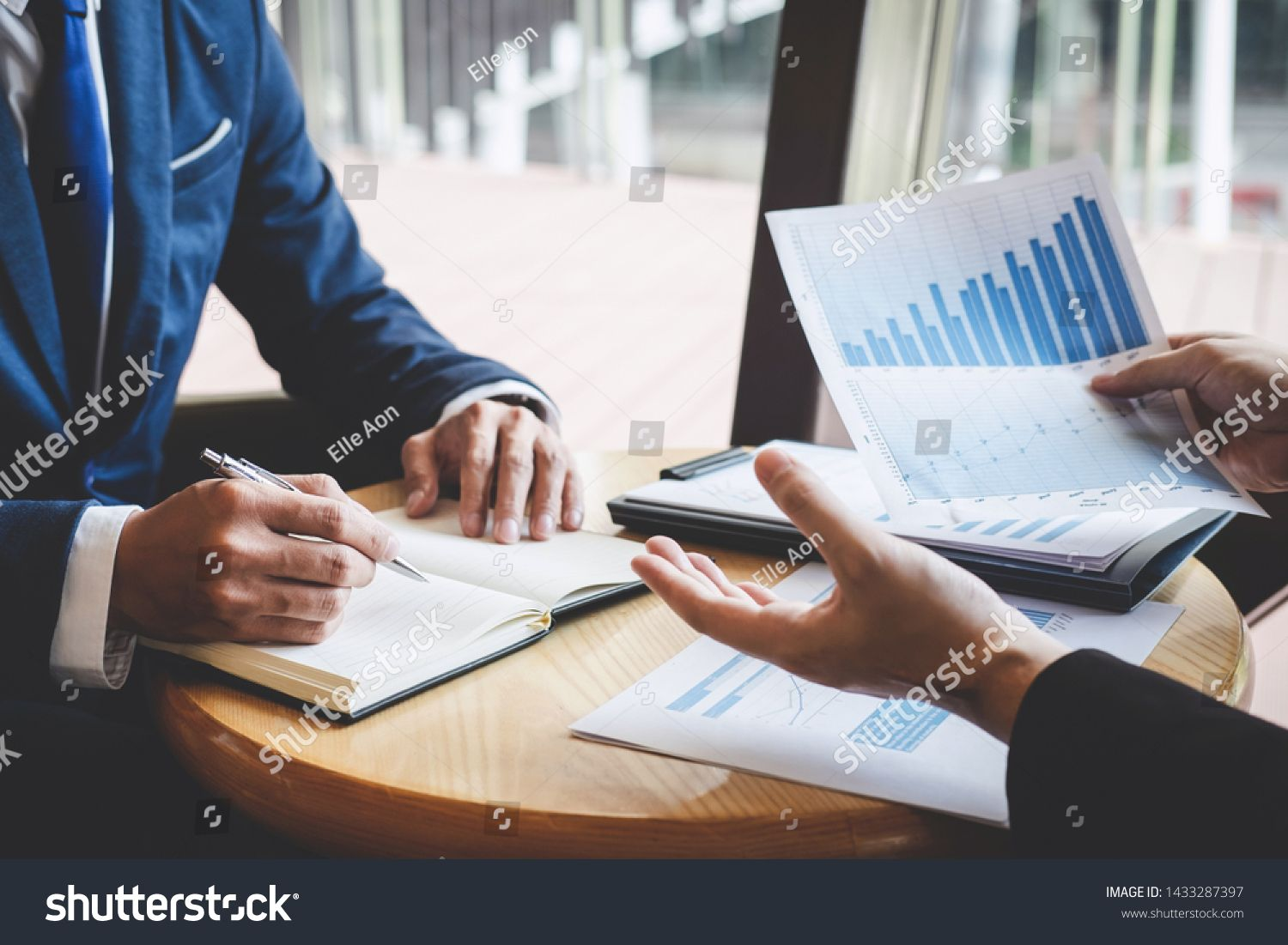 Professional Business partner team discussing on meeting to presentation planning investment project working analyzing and strategy of business making conversation with p...
