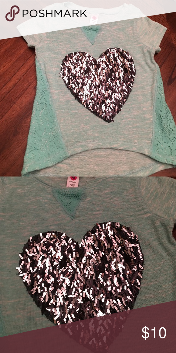 Size 10-12 heart sweater Barely worn girl medium 10-12 heart shirt short sleeved sweater. Total girl Shirts & Tops Sweaters