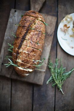 Crusty loaf with rosemary and butter