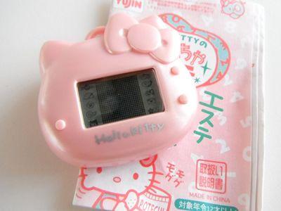 112efb46290a I want this Hello Kitty Tamagotchi!