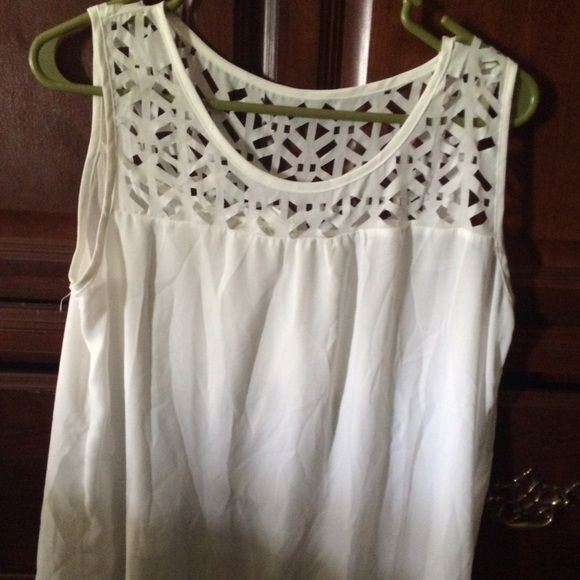 White sheer sleeveless top Very cute I love this, never worn bc it's a tad see thru and the hubs isn't having it. Mine Tops