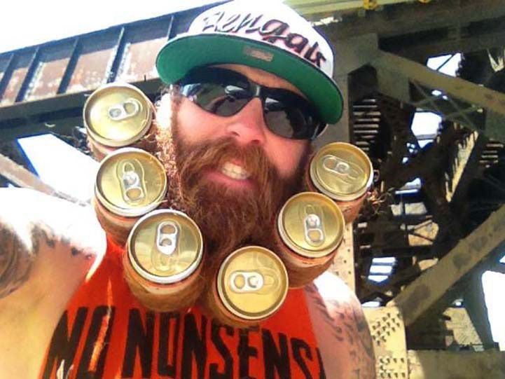 Beer beard stores 6-pack.This is the best use of a long beard I've seen yet. If you're a guy who likes beer, maybe you'll consider growing your own beer beard. You will completely eliminate the need to carry a cooler into the game. Instead, your beer will stay snugly safe and sound, right there, hanging off your face.