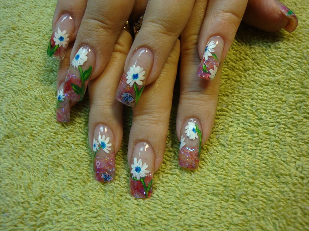 I love daisies! :)  My own hand-painted flowers....Nail Art by Leah