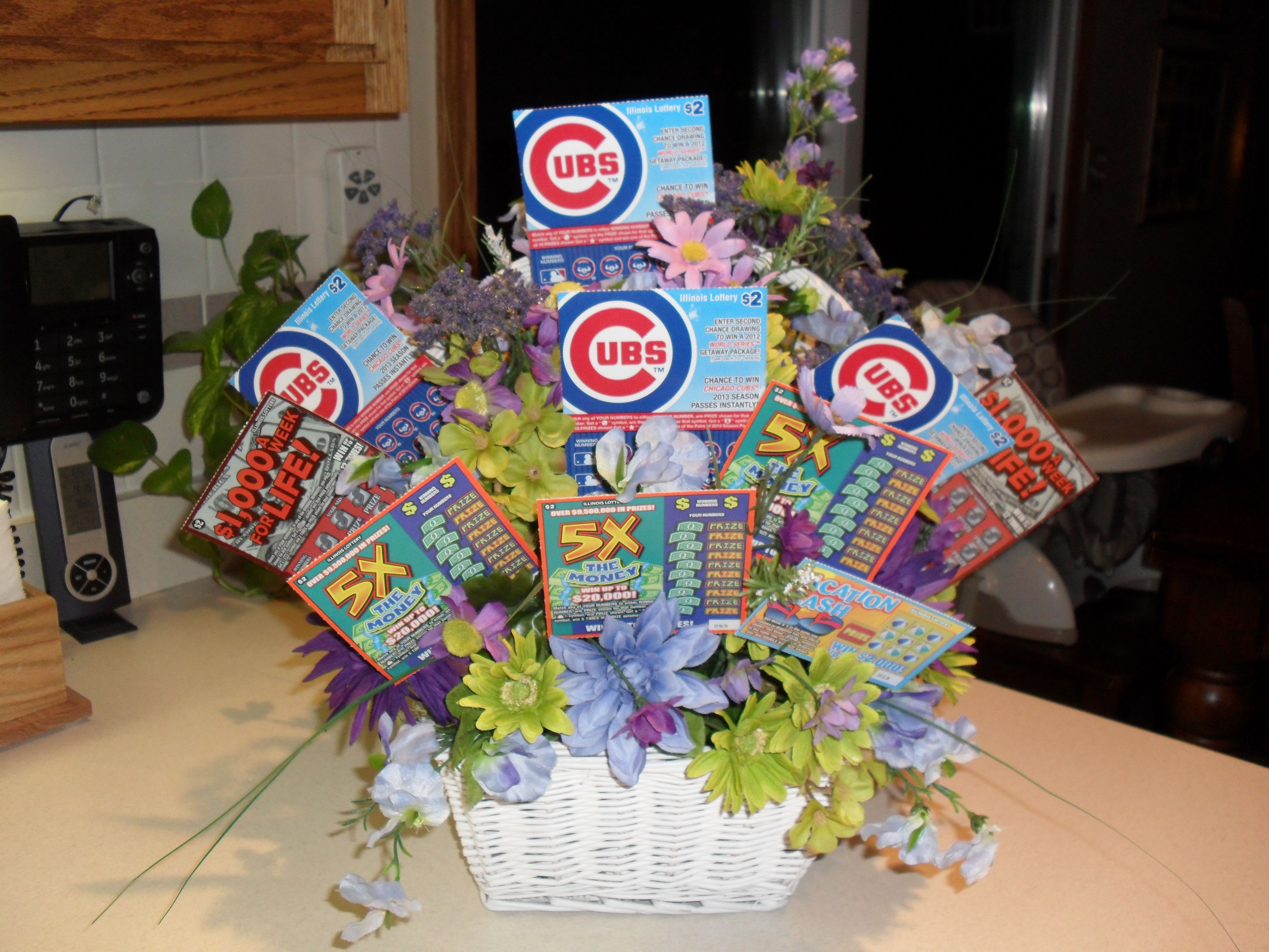 Artificial floral arrangement with instant lottery tickets