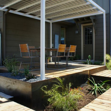 Open Envelope Studio | cedar deck with steel planters, a