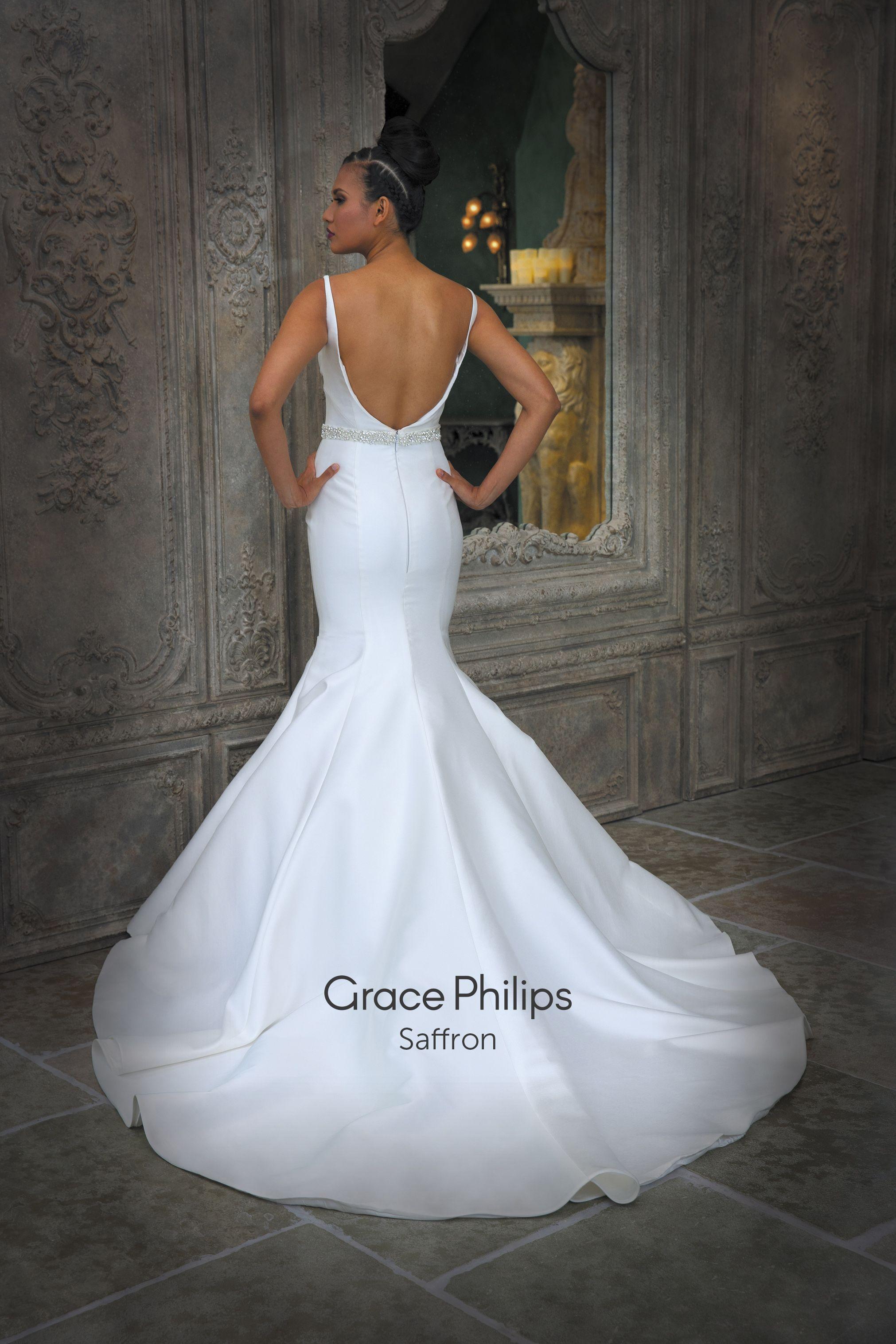 An ivory Mikado classic fishtail wedding dress with detachable train ...