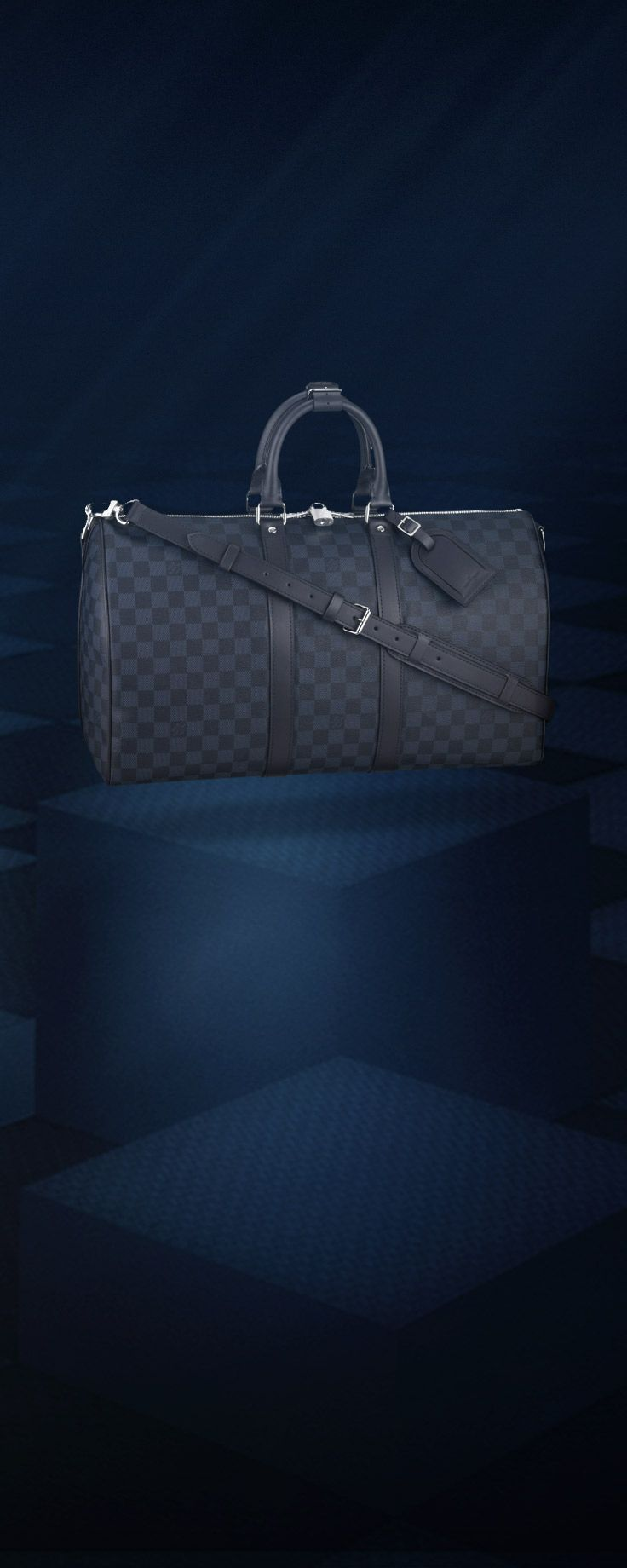 The Louis Vuitton Keepall, the classic revisited in the new Damier Cobalt canvas.