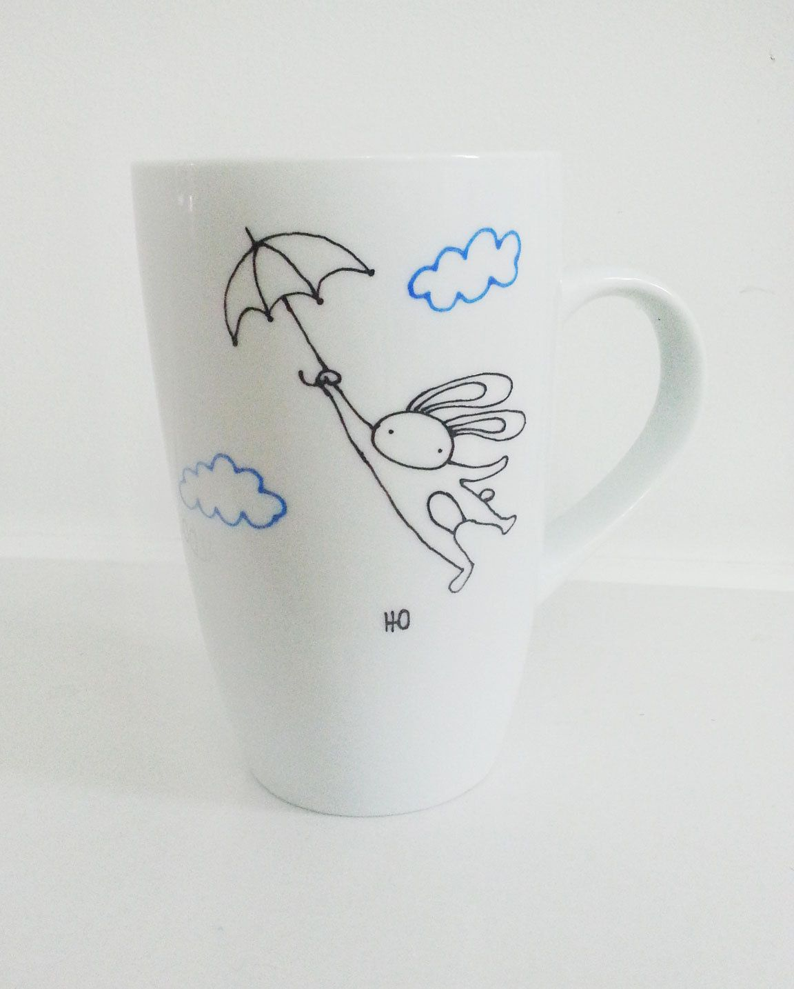 flying bunny with umbrella hand painted porcelain coffee tea mug