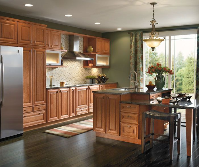 light cherry kitchen cabinets. This galley kitchen featuring light Cherry cabinets utilizes one wall and a  small island allowing for easy interaction with the living area beyond Don t let space stump your design sensibility Utilizing