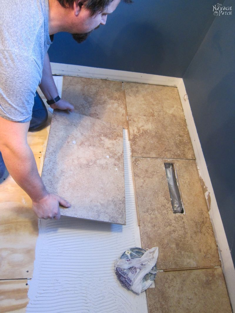 Guest bathroom renovation how to tile a floor like a pro diy guest bathroom renovation how to tile a floor like a pro diy floor tiling how to cut tiles how to repair broken ceramic tiles how to lay dailygadgetfo Gallery