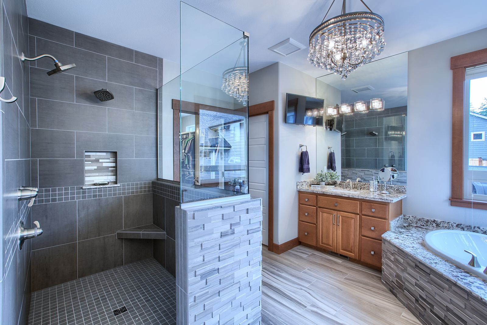 Keep your shower low maintenance with only a partial glass wall and ...