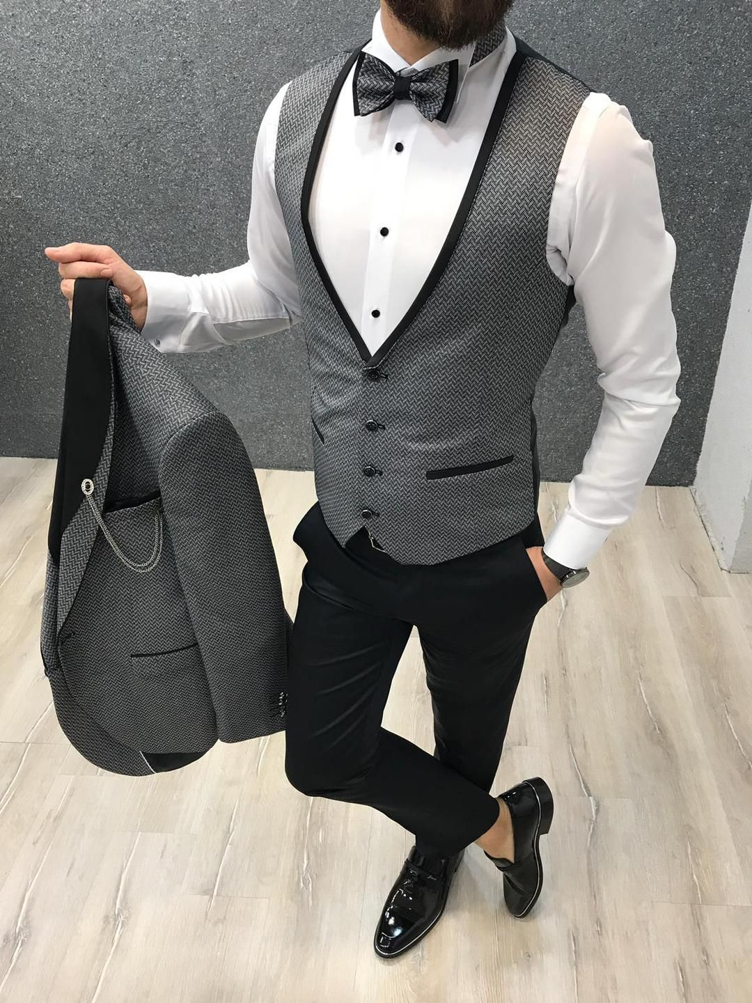 Ferrar Shawl Collared Grey Suit (Wedding Collection) is part of Grey suit wedding -  Groom CollectionsColor code  Grey Size  464850525456   Suit material 70% Viscose, 30% Polyester   Machine Washable  No   Fitting  Regular Slim Fit Set Jacket, Vest & Pants Remarks Dry Cleaning Only