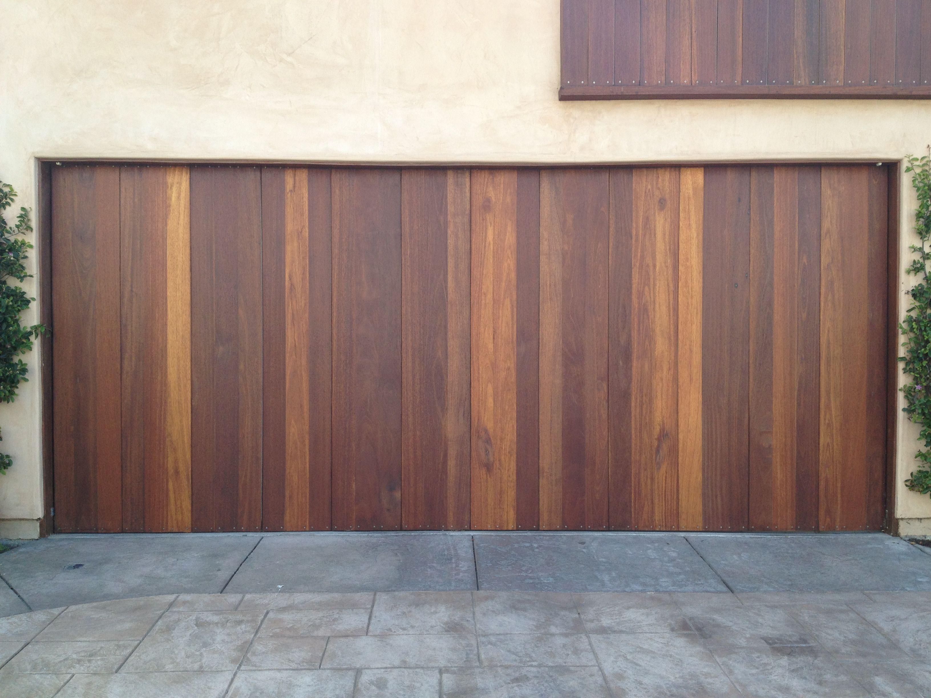 Beautiful Beach Custom Wood Vertical Redwood Garage Door Los Angeles Ca Photo Credit Agi Dyer Ga Contemporary Garage Doors Modern Garage Doors Garage Doors