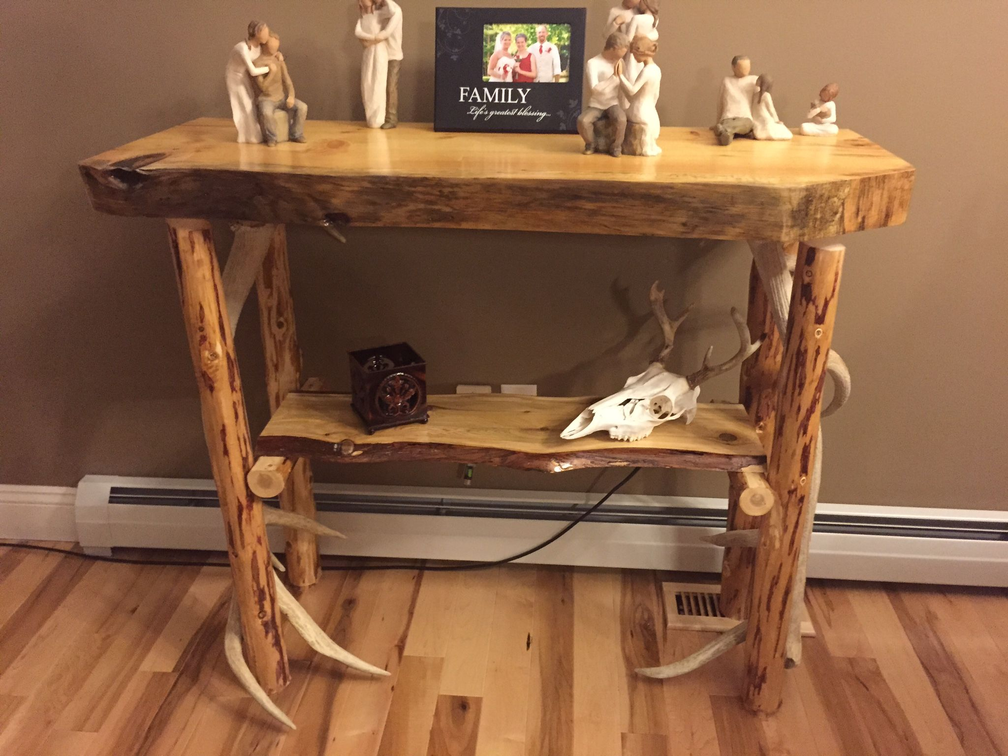 Log and antler sofa table Top is made from 3 inch thick pine