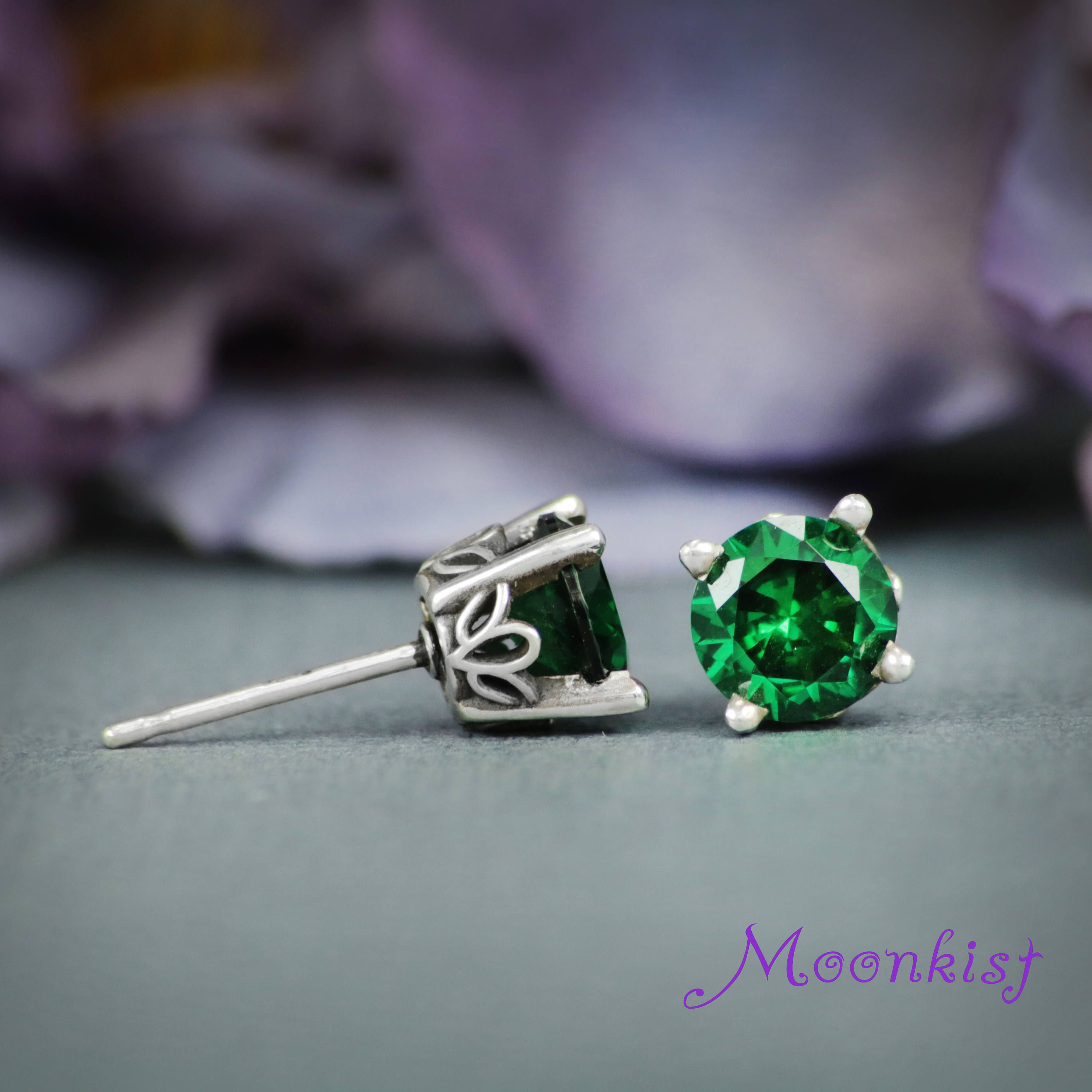 Featuring bright, sparkling laboratory-grown green spinel that ...