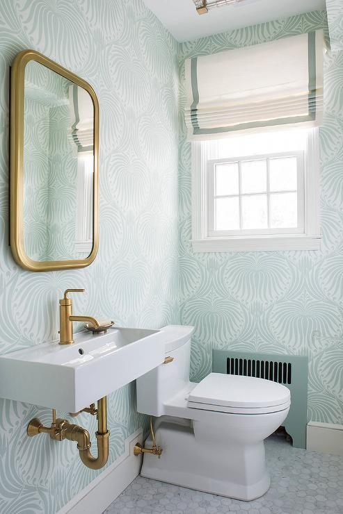 Sea foam green powder room feature walls clad in green Farrow & Ball ...