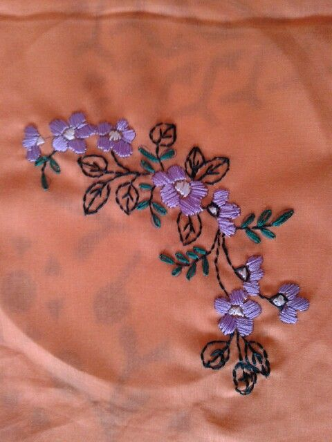 Flower embroidery on a cushion cover