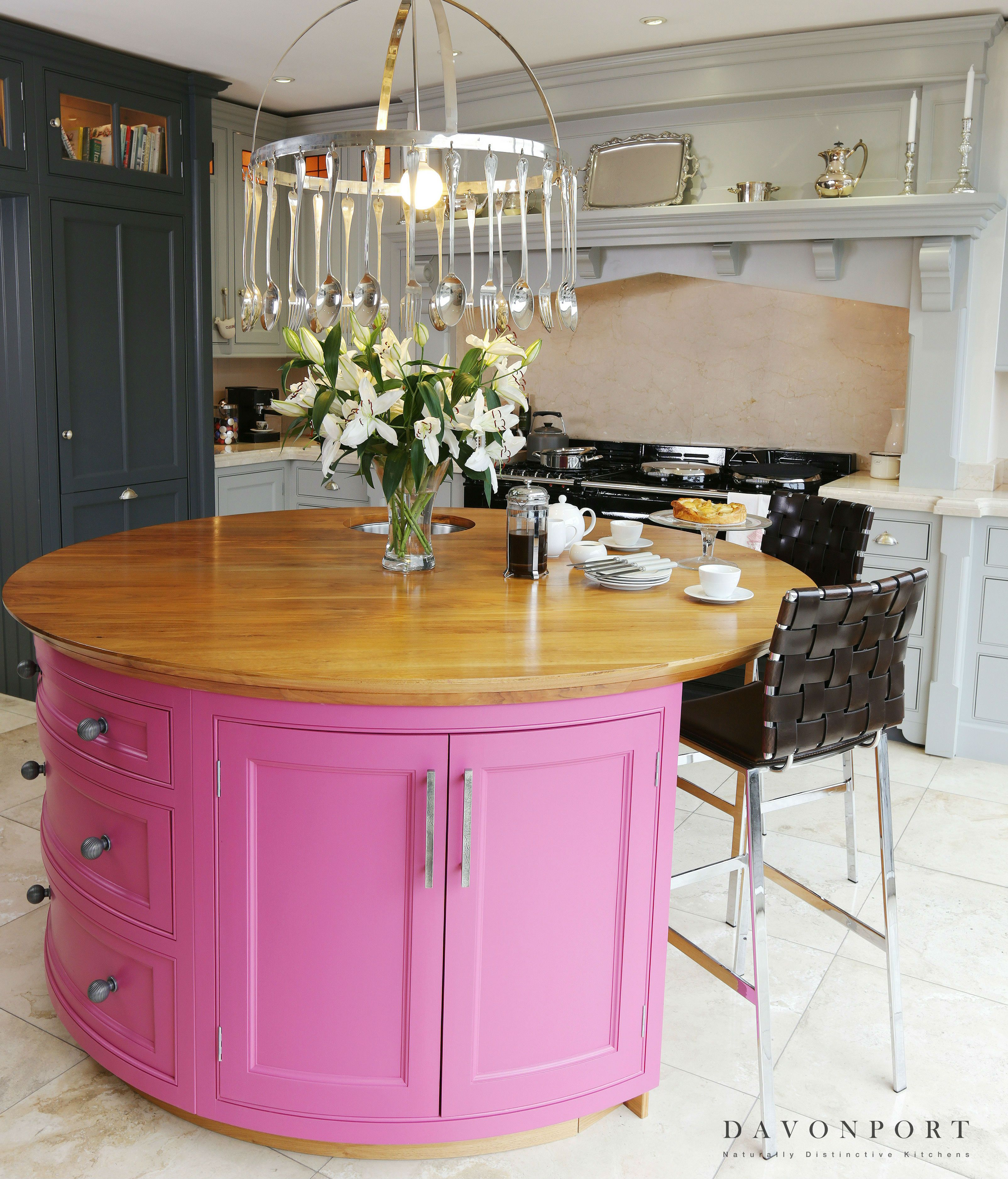 An island is a great place to inject some colour into the kitchen set against a palette of greys the striking pink colour of this island uplifts the feel