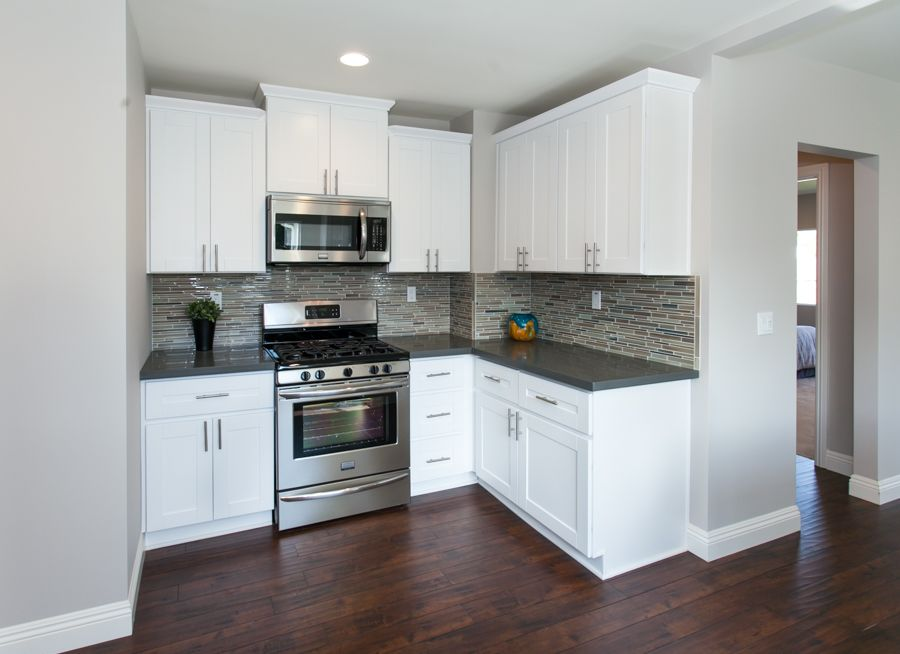 Modern Kitchen With Warm Wood Floors Gray Paint White Cabinets