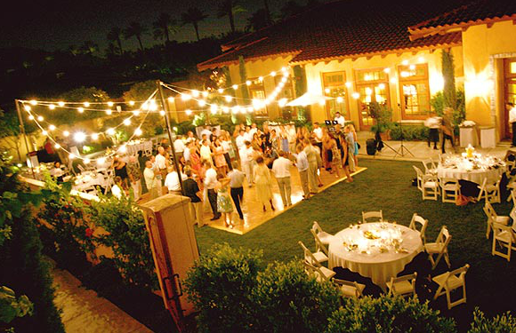 Beautiful Backyard Summer Wedding Reception With Stringed Lights Small Dance Floor Circle Tables White Padded Folding Chairs At Miramonte Resort