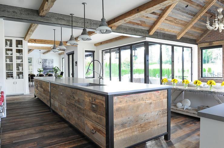 Long Reclaimed Wood Plank Kitchen Island Boasts An Industrial Farm Style Mix Under Metal Cei Reclaimed Wood Kitchen Outdoor Kitchen Design Metal Kitchen Island
