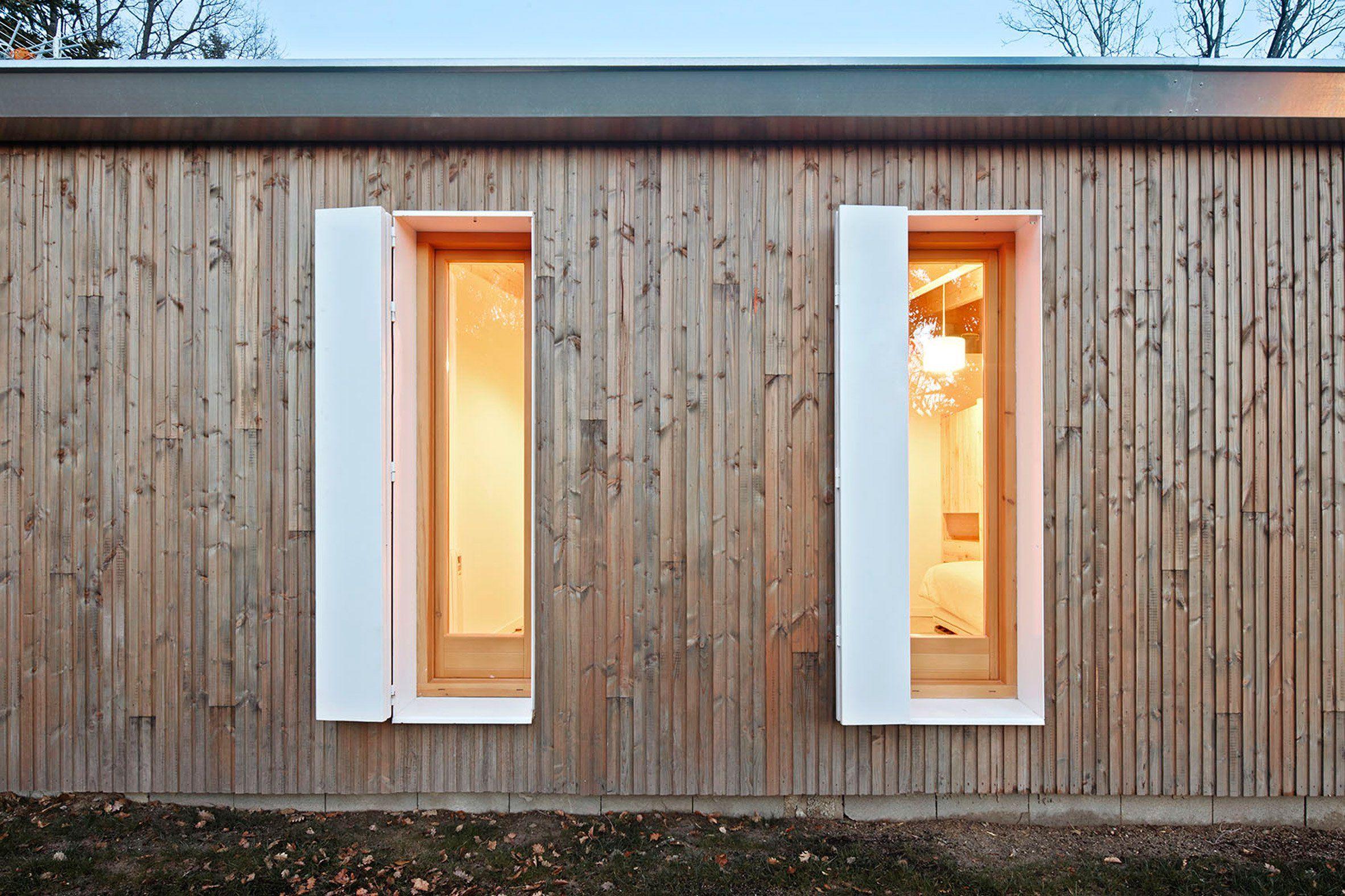 Prefab cottage designed as a costconscious summer retreat