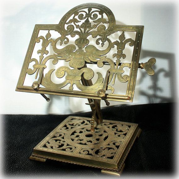 Rare Victorian pierced brass book rest or reading stand which is easily adjusted by a butterfly tightening lock and a ratcheting device. Built