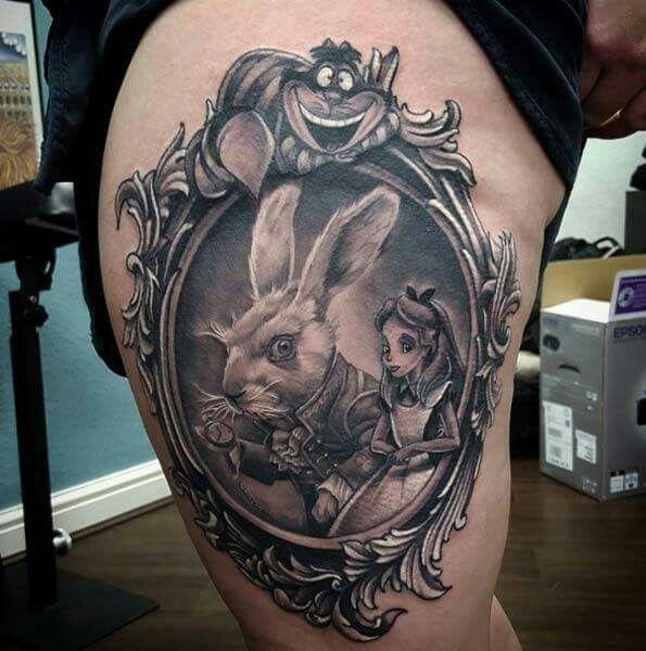 Love this Alice in wonderland tattoo.