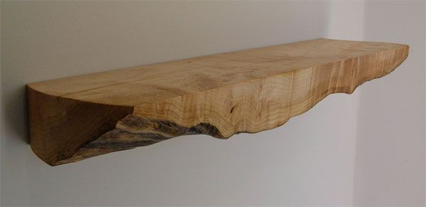 Live edge shelving in the display alcove.