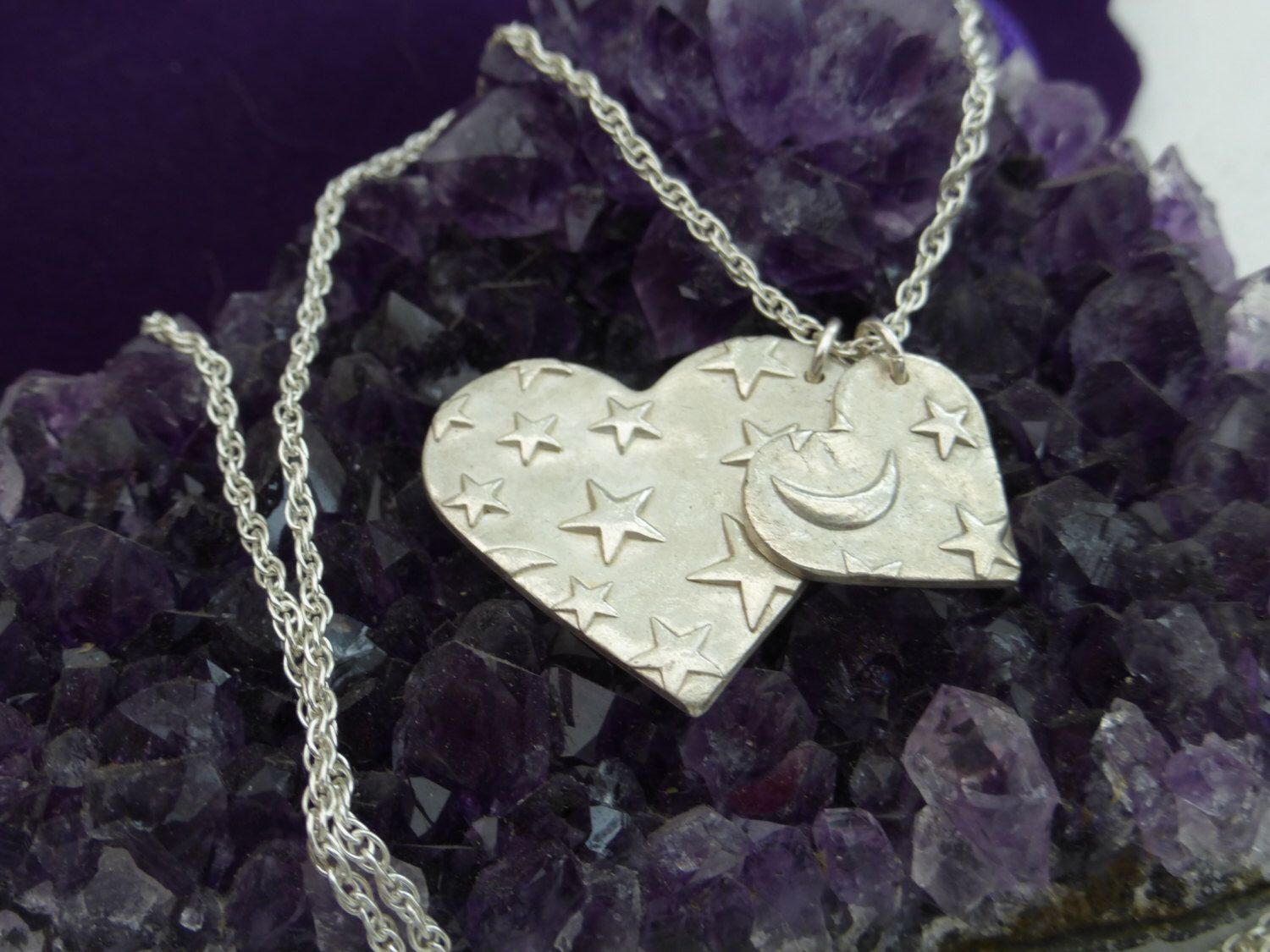 A personal favourite from my Etsy shop https://www.etsy.com/uk/listing/465083161/fine-silver-double-heart-necklace