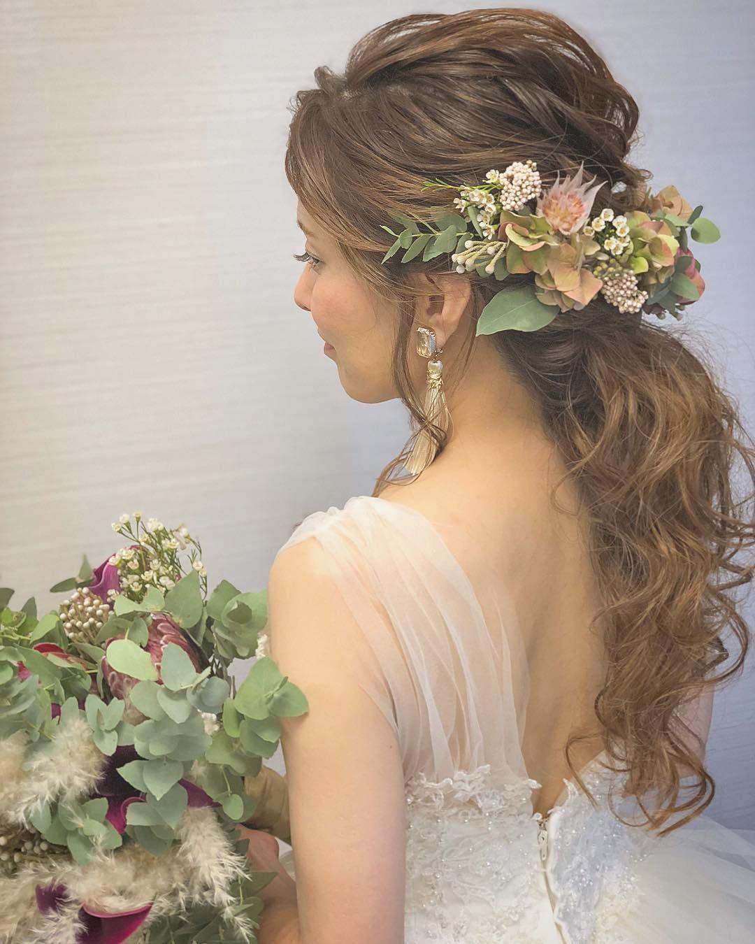 前撮りヘアやお色直しヘアに ポニーテール のブライダルヘアアレンジまとめ Marry マリー ウェディング ヘア 生花