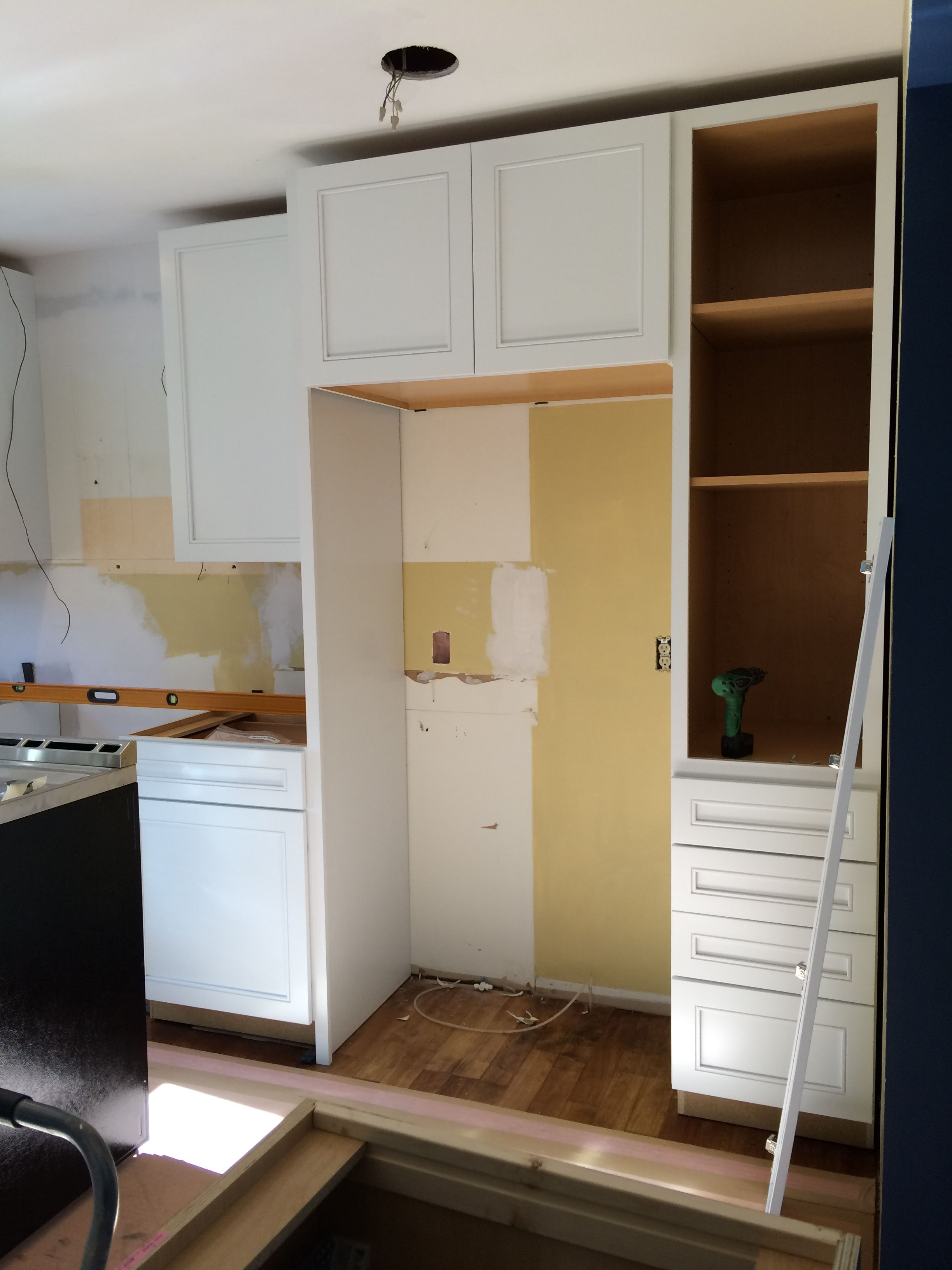 Kitchen renovation cabinet installation using kraftmaid before