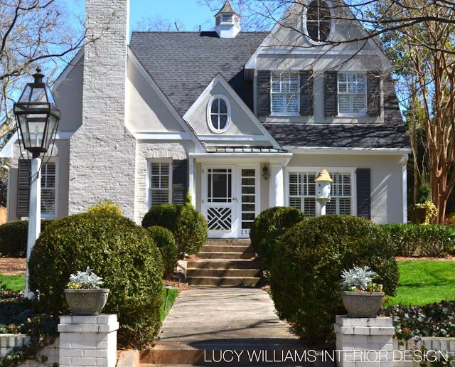 Painted brick white trim chippendale door and sidelights for Beautiful home exteriors
