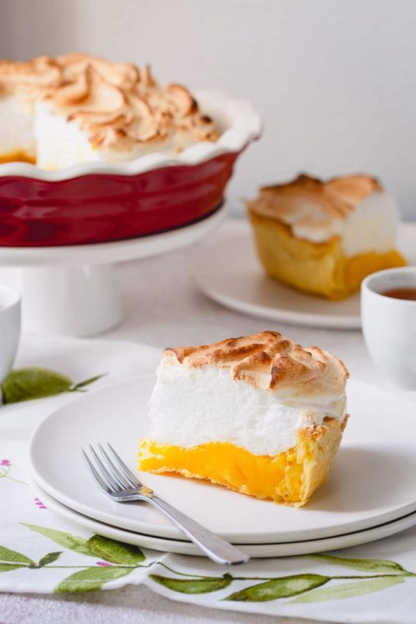 Classic lemon meringue pie recipe with lots of tips and tricks for a perfect pie every time! No more weeping and shrinking.This's the BEST! #lemonmeringuepie