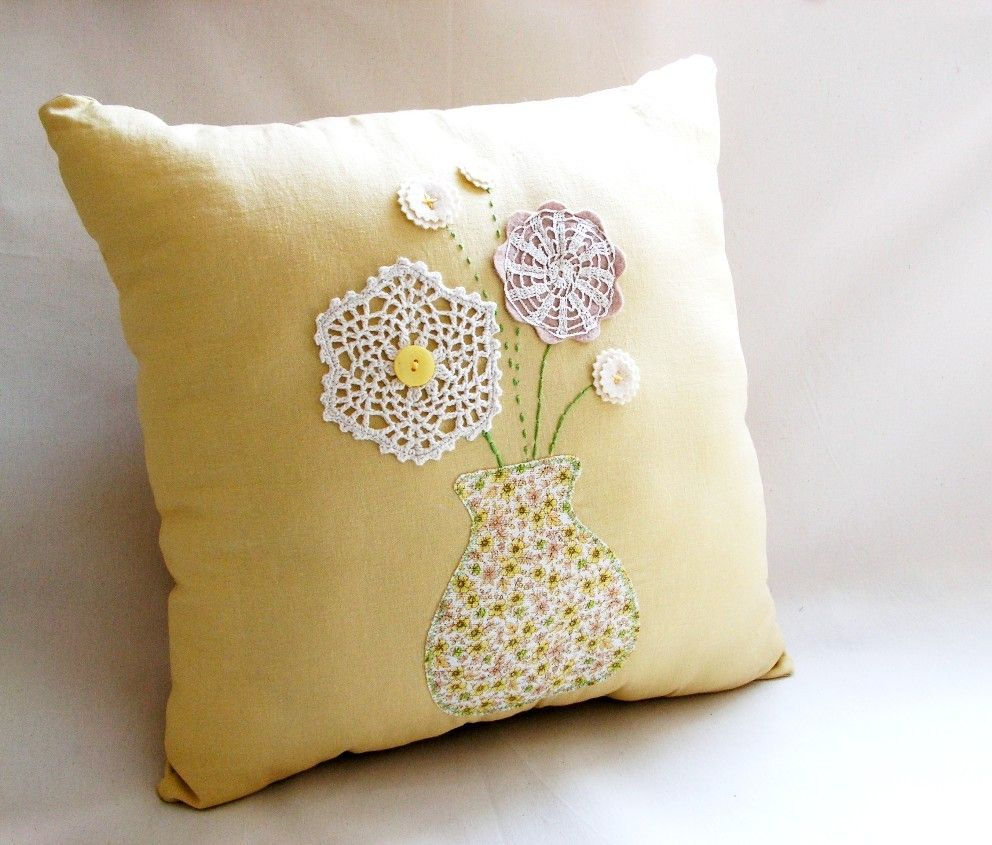 Vintage Doily Pillow  - created to look like a vase of flowers.  Adorable!