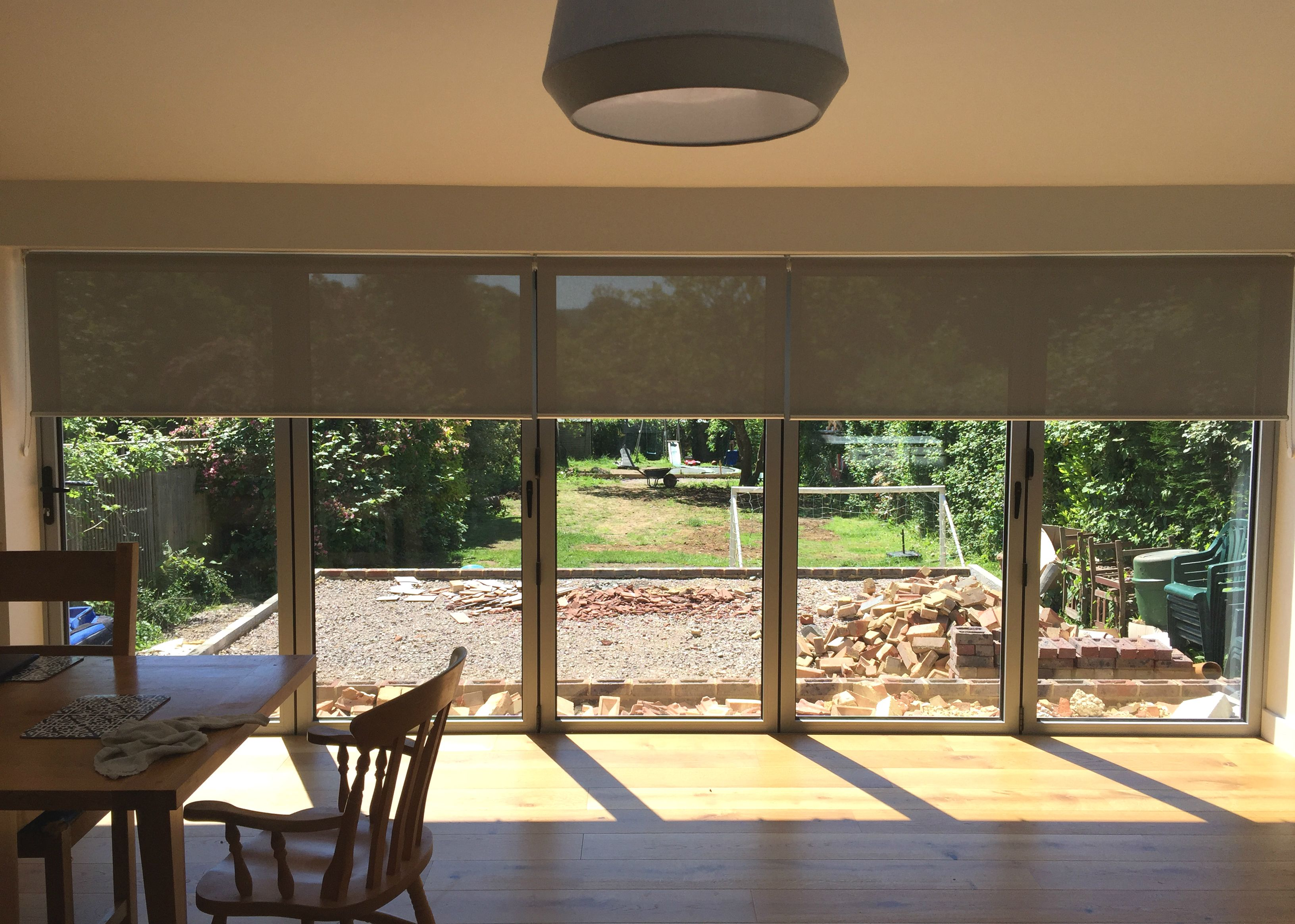 Sunscreen Roller Blinds In Steel Grey Colour Installed To Bifold