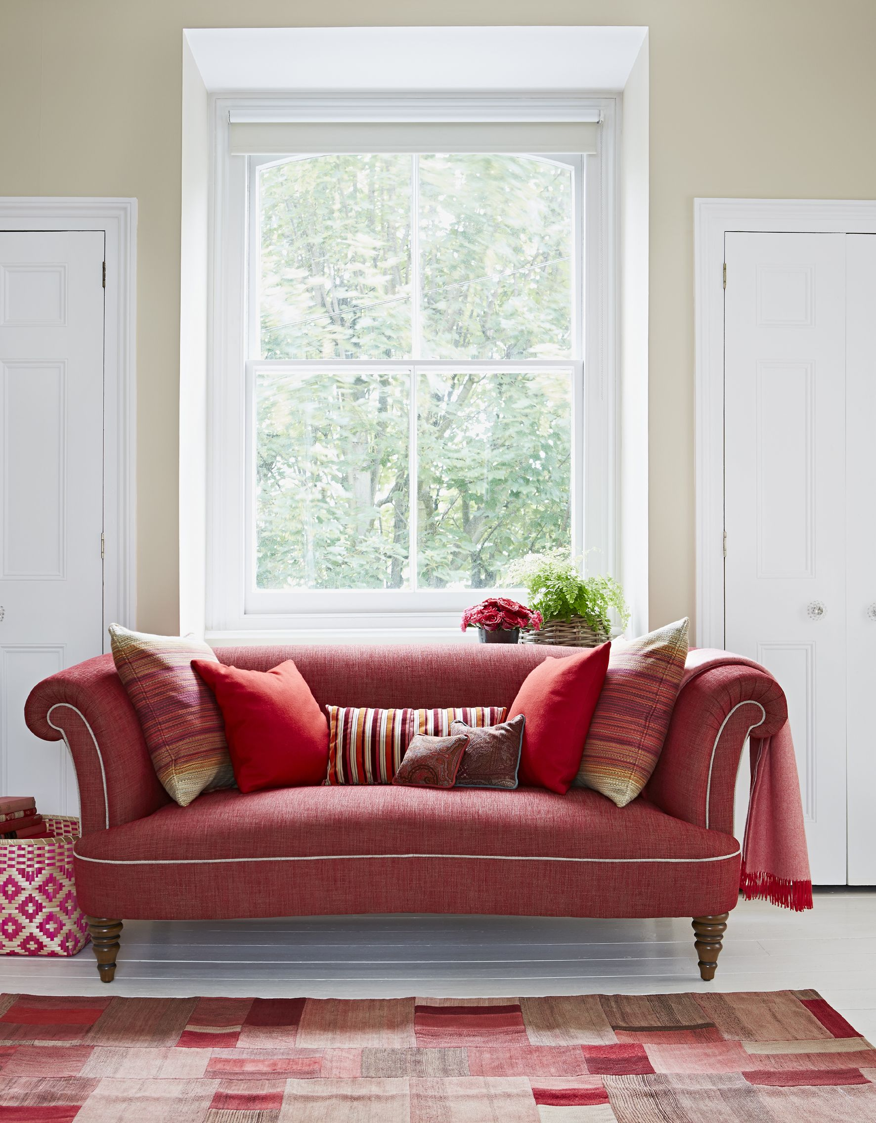 This curvy red Isabelle medium sofa from Parker Knoll is a