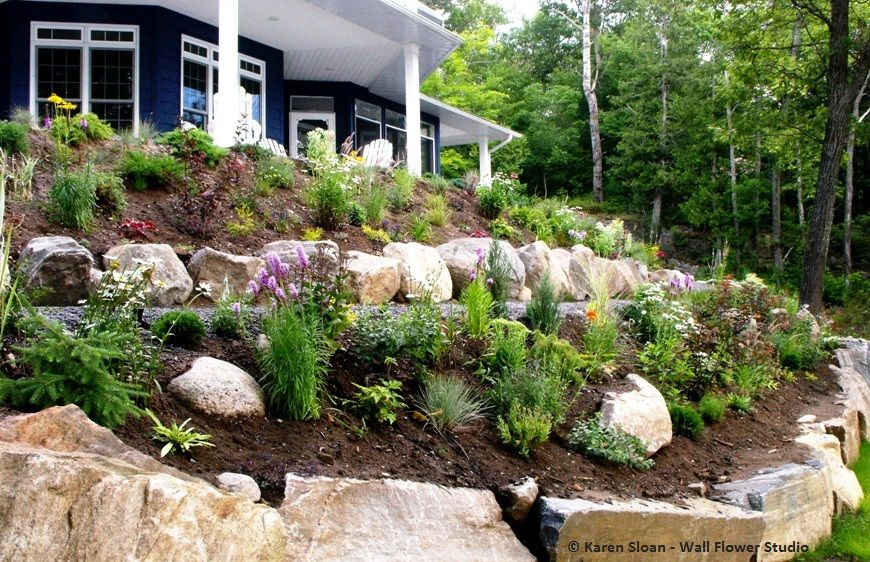 Hillside landscape. Two-tiered garden - 60 ft. beds. Perennial plant ...