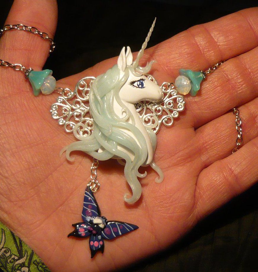 Handmade Necklace by Ganjamira on DeviantArt. I love how the mane and horn are such florescent colors and is just a stunning piece of art.