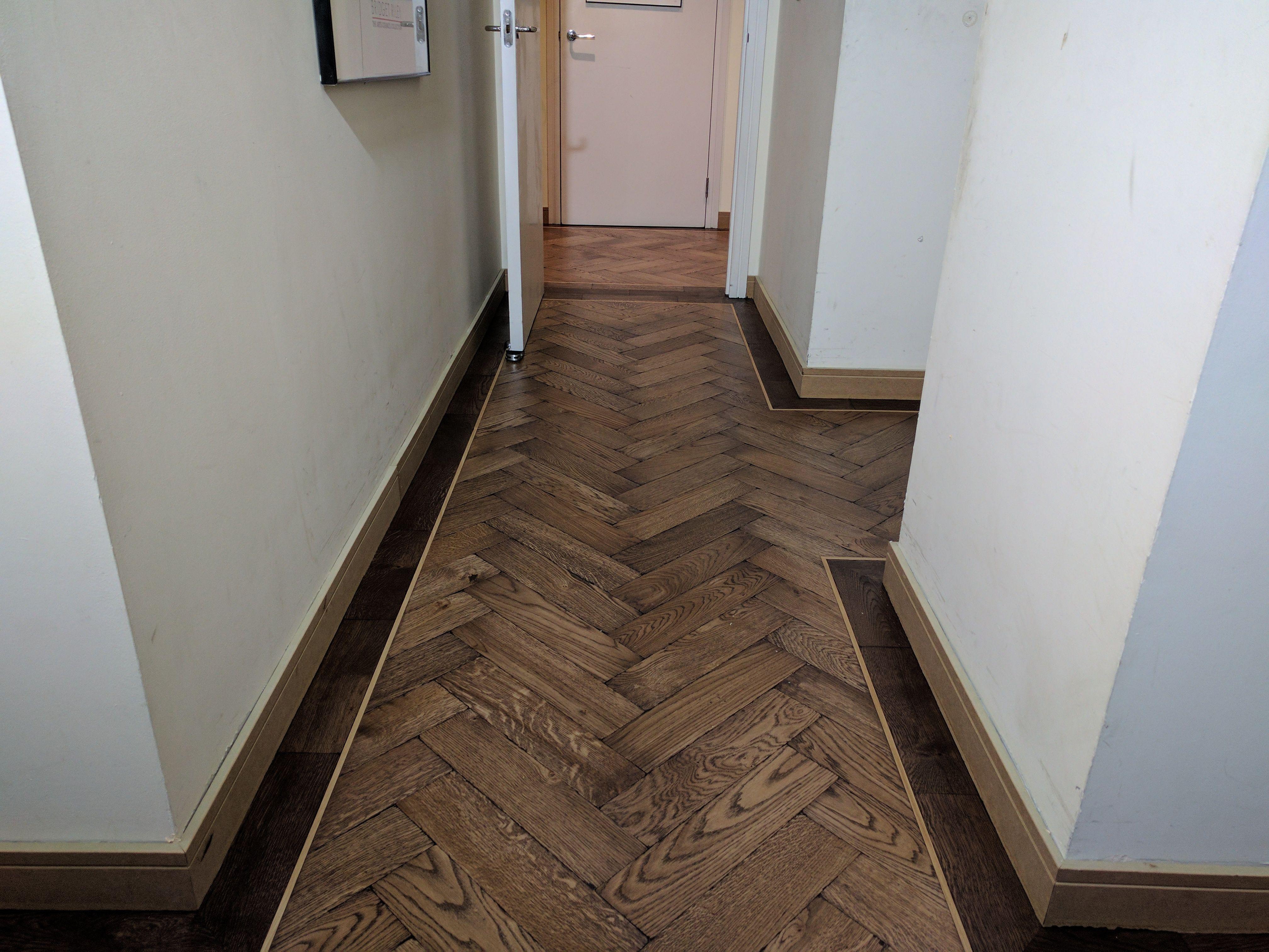 We fitted this dark parquet wood floor in a herringbone