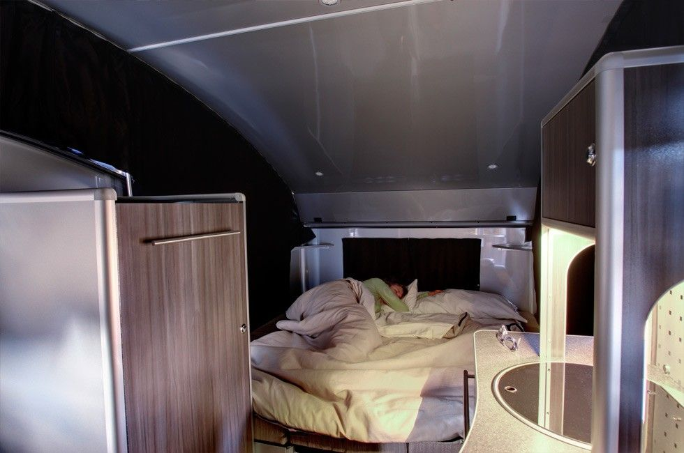 Compact teardrop trailer transforms into a large family