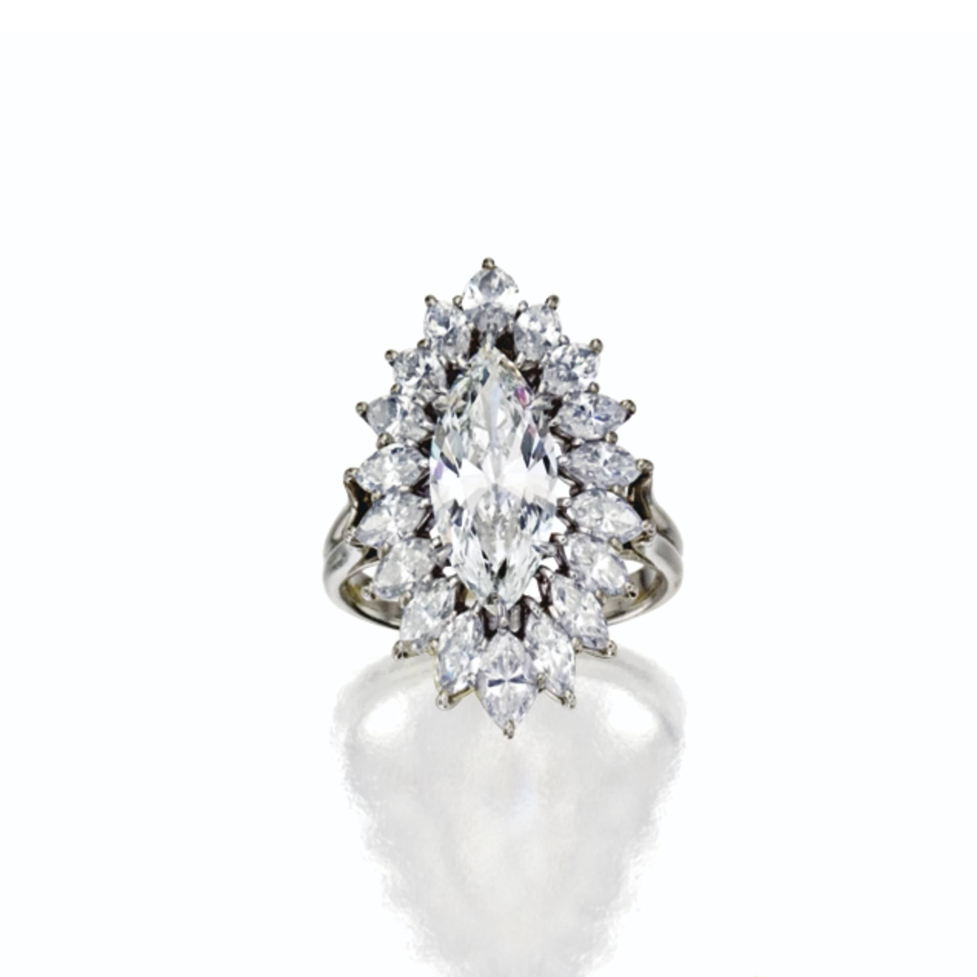 DIAMOND RING, HARRY WINSTON Centering a marquise-shaped diamond weighing 2.21 carats, framed by 18 marquise- shaped diamonds weighing approximately 2.55 carats, mounted in platinum, size 6. With Winston box.