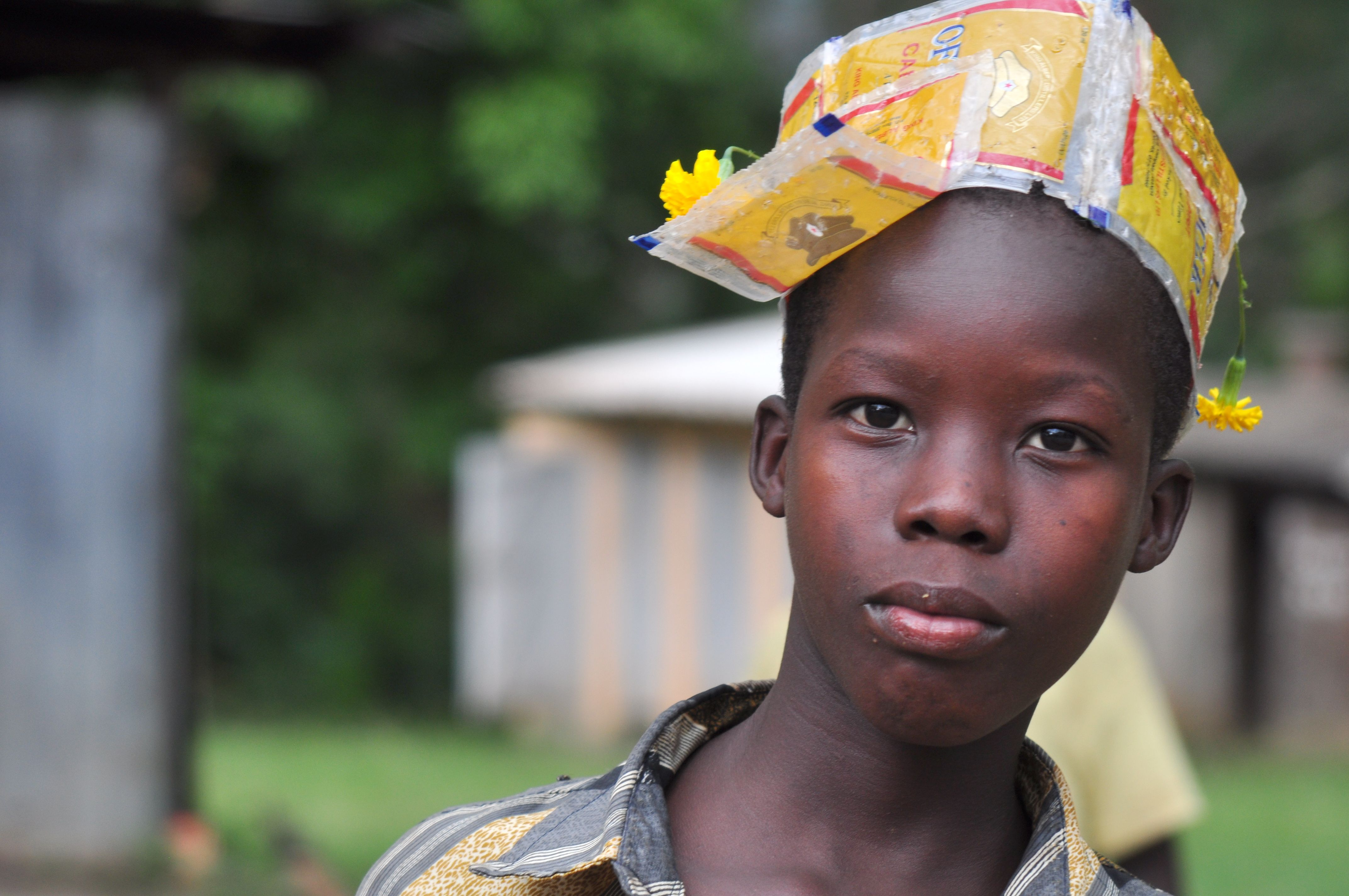Pakwach, Uganda - He wanted a real baseball hat...so he made one out of wrappers.  2010 - photo - staci j guthrie