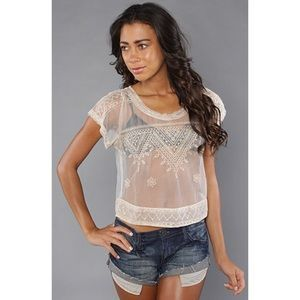 I just discovered this while shopping on Poshmark: Free People 'The Vicki' Lace Embroidered Mesh Crop. Check it out! Size: M