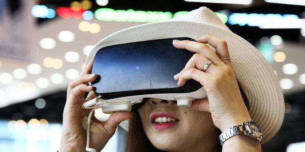 Global Tech Leaders To Convene In Auckland A Customer Tries A Samsung Electronics Co Gear Vr Virtual Virtual Reality Gear Virtual Reality Newest Smartphones