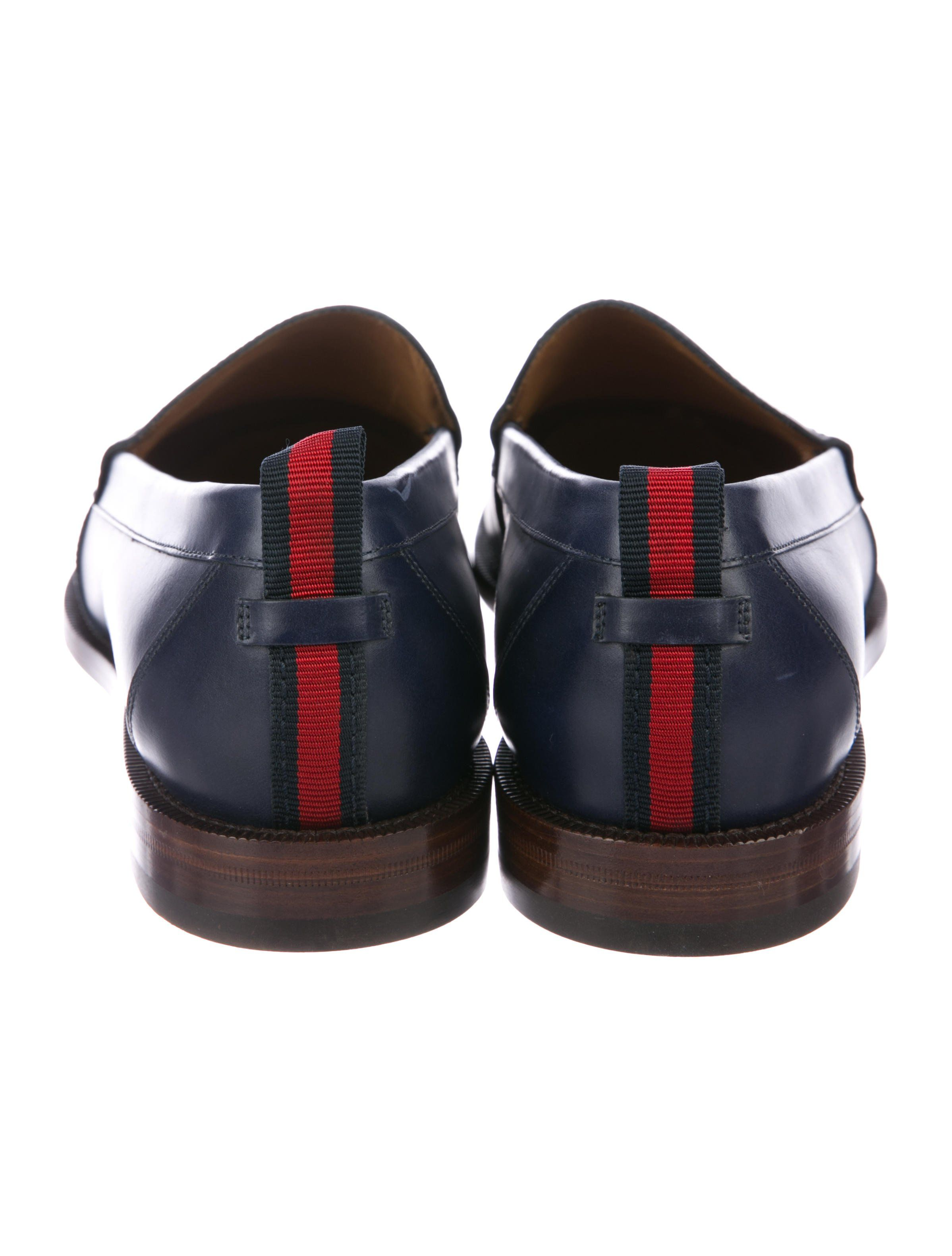 5e3ca30c082 Men s navy leather Gucci round-toe penny loafers with Web trim at counters  and stacked