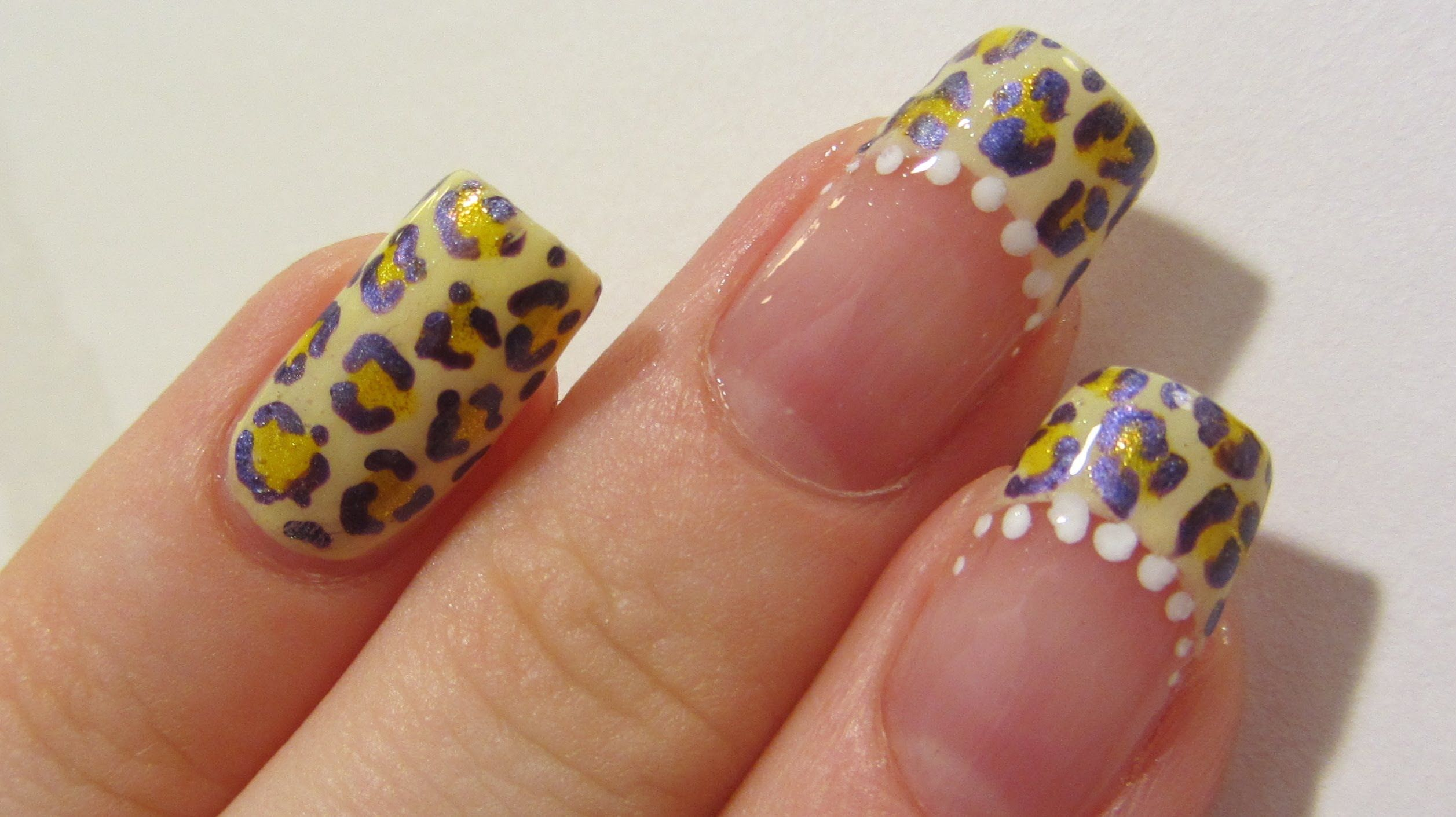 Yellow And Violet Banana Leopard Design Using Gel Pens Nail Art