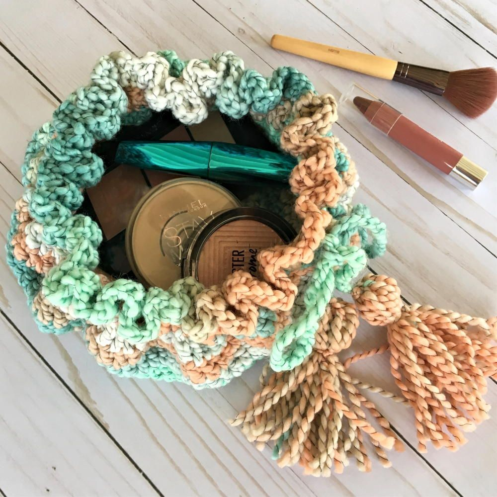 """""""This crochet drawstring makeup bag pattern is quick to"""