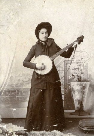 C. 1900 photograph of Irena Arnold playing the banjo in her Salvation Army uniform. (Salvation Army Historical Center)